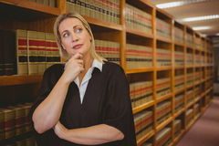 Serious lawyer thinking with hand on chin Stock Photo