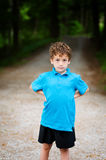 Serious little boy. Adorable little boy outdoors with a serious expression Stock Images