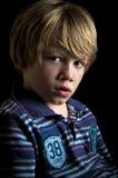 A serious little boy Royalty Free Stock Photos