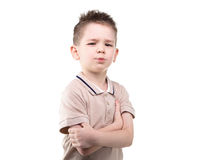 Serious little boy with arms crossed Stock Photo