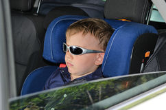 Serious little boy in car Stock Image