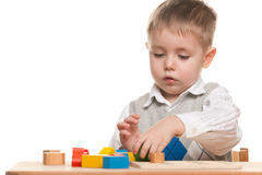 Serious little boy at the desk Royalty Free Stock Image