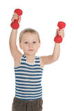 Serious little boy with dumbbells Royalty Free Stock Images