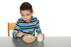 Serious little boy eats his breakfast Royalty Free Stock Photo