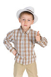 Serious little boy holds his thumb up Royalty Free Stock Images