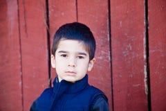Serious Little Boy Making Eye Contact Stock Image