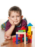 Serious little boy near toys Stock Image