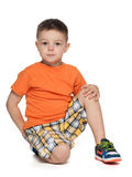Serious little boy in the orange shirt Royalty Free Stock Images