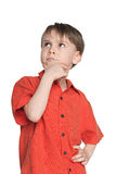 Serious little boy in a red shirt Royalty Free Stock Photos