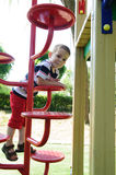 Serious little boy sitting at playground Royalty Free Stock Photos