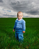 Serious little boy standing Royalty Free Stock Photography