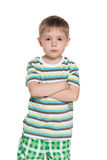 Serious little boy in striped shirt Royalty Free Stock Images