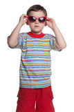 Serious little boy with sunglasses Royalty Free Stock Image