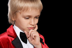 Serious  little boy in a tuxedo Stock Photography