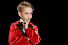 Serious  little boy in a tuxedo Royalty Free Stock Photo