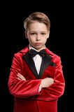 Serious  little boy in a tuxedo Stock Photos