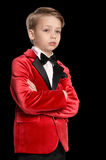 Serious  little boy in a tuxedo Royalty Free Stock Images