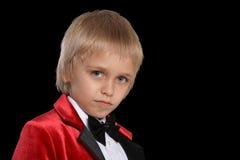 Serious  little boy in a tuxedo Stock Image