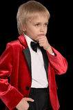 Serious  little boy in a tuxedo Royalty Free Stock Image