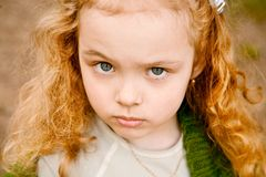 Serious little girl Stock Images
