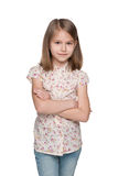 Serious little girl against the white background Royalty Free Stock Photo