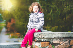 Serious little girl. Stock Photo