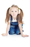 Serious little girl in blue jeans Royalty Free Stock Images