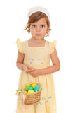 Serious little girl with Easter basket. A portrait of a little girl with the Easter basket; isolated on the white background Stock Photos