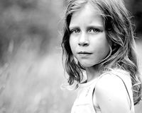 Serious Little Girl in Field Stock Photos