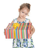 Serious little girl with a gift box Royalty Free Stock Image
