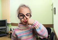 Serious little girl in glasses Stock Photos