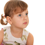 Serious little girl is looking away Royalty Free Stock Photos
