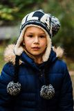 Serious little girl with winter hat smiling Stock Photo
