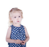 Serious little girl 3 years old, isolated on white background. Royalty Free Stock Photo