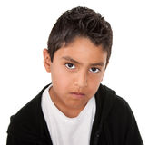 Serious Little Man. Young hispanic boy with a serious attitude on a white background Stock Photography