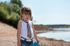 Serious little model posing on lake background Stock Photography