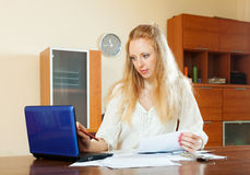 Serious  long-haired woman working with financial documents Stock Photography
