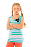 Serious look school age girl waist up portrait stock images