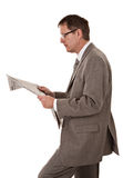 Serious Looking Businessman Reading Newspaper Royalty Free Stock Photos