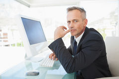 Serious looking businessman at work Royalty Free Stock Photo