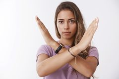 Serious-looking fed up woman decide finish inappropriate behaviour showing cross stop gesture frowing disapproval. Saying no, forbid you, expressing dislike stock photos
