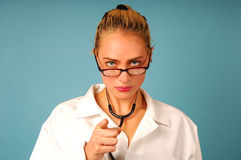 Serious looking female doctor Royalty Free Stock Photo
