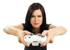 Serious looking girl plays video game Stock Photos