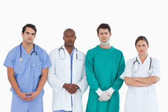 Serious looking medical team standing together Stock Images