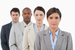 Serious looking salesteam standing together Royalty Free Stock Photos