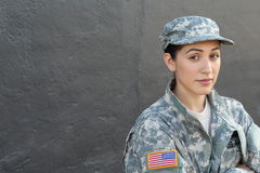 Serious looking servicewoman with copy space Royalty Free Stock Photo