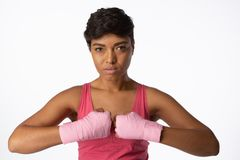 Serious looking woman for breast cancer awareness. On white background royalty free stock images