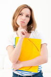 Serious looking woman with folders Stock Image
