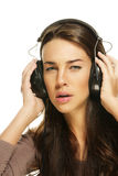 Serious looking woman listening to music Royalty Free Stock Image