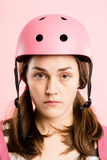 Funny woman wearing Cycling Helmet portrait pink background real Royalty Free Stock Images